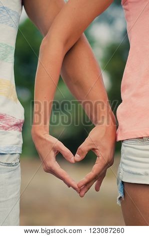 Hands in heart shape. Sweethearts make heart