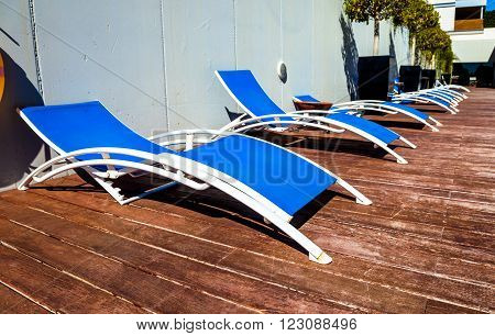 Several deckchairs near of the swimming pool