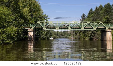 St-Didace Qc Canada - July 27 2015 : two quadbike crossing bridge over Maskinongé river at daytime in summer. St-Didace is a small village of Lanaudiere in Quebec Canada