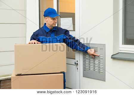 Delivery Man Using Intercom To Enter Home