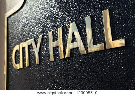 City Hall building entrance sign close up
