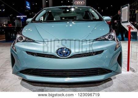 NEW YORK - March 23: A Toyota Prius exhibit at the 2016 New York International Auto Show during Press day,  public show is running from March 25th through April 3, 2016 in New York, NY.