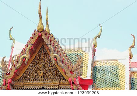 colorful roof tiles and gold gable apex architecture in thailand temple. In Thailand public domain or treasure of Buddhism. no copyright and no name of artist appear.