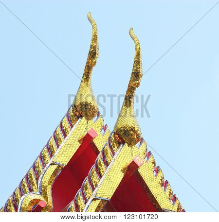 gold of gable apex architecture in thailand temple. In Thailand public domain or treasure of Buddhism. no copyright and no name of artist appear. poster