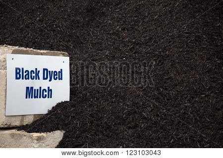 bulk pile of black dyed mulch used for landscaping projects