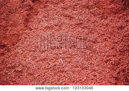bulk pile of red dyed mulch for landscaping gardens and yards poster
