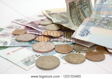 Russian paper and metal money on the white background