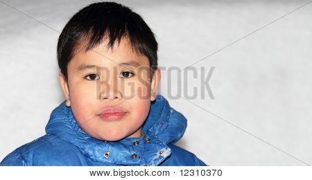 Adorable Boy In Winter Clothes