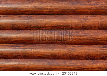 New log texture as background with a copy of the space. Brown horizontal logs