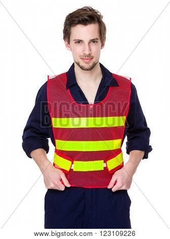 Smiling worker in a reflective vest
