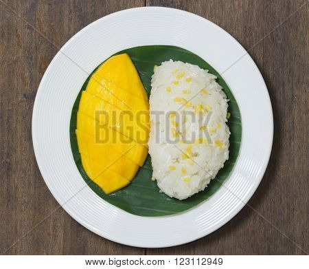 Mango Sticky Rice With Peeled Split Mung Bean On White Plate