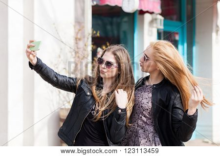 Girls Making A Selfie With The Cellphone Outside