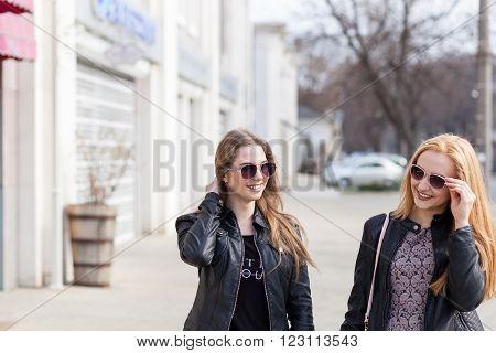 Two Female Friends Enjoying A Walk In Sunny Wheather