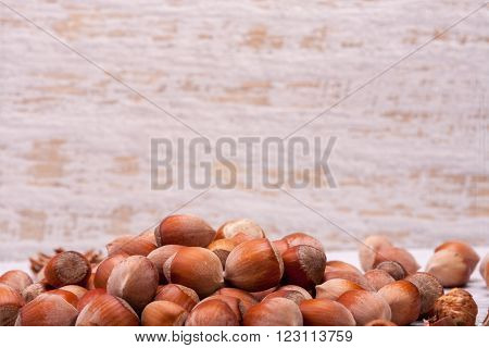 Nuts On White Wooden Background In Studio Photo