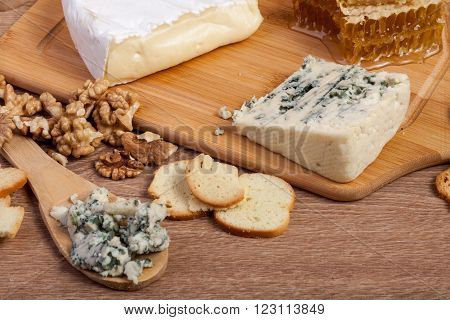 Different Type Of Expensive Cheese On Wooden Background