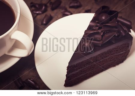 Chocolate Cake Topping With Chocolate Curl On Wood Background, Vintage Toning