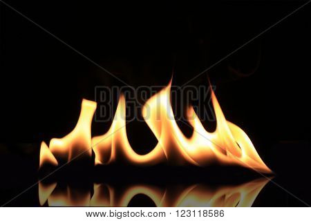 Burning flames isolated on a black background.