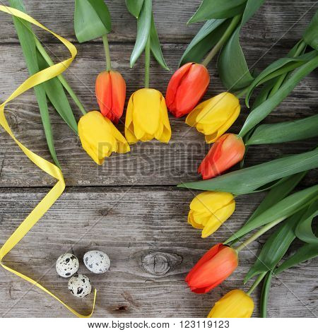 Bouquet Of Yellow And Red Tulips And Easter Eggs