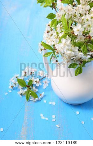 Bouquet Of Cherry Blossoms On A  Wooden Background