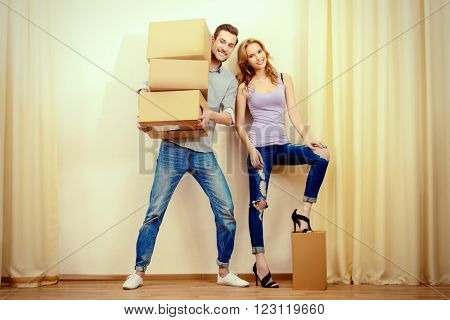 Happy young people moving to a new home. Apartment repair. Real estate, mortgage.