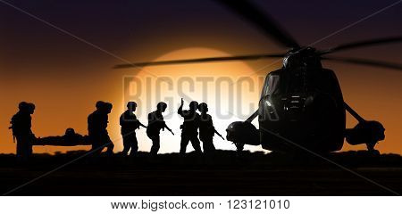 Rescue helicopter with soldiers on ground during sunset