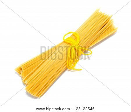 Uncooked Italian spaghetti isolated on a white background
