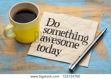 do something awesome today - advice or reminder - handwriting on a napkin with a cup of coffee