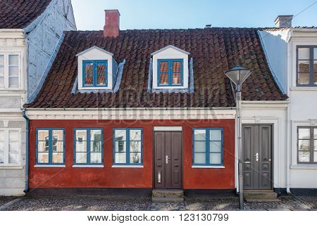 Old homes in cobbled streets in Odense the city of Hans Christian Andersen Denmark