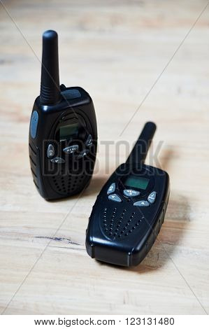 Two black compact professional portable radio sets with maps ** Note: Soft Focus at 100%, best at smaller sizes