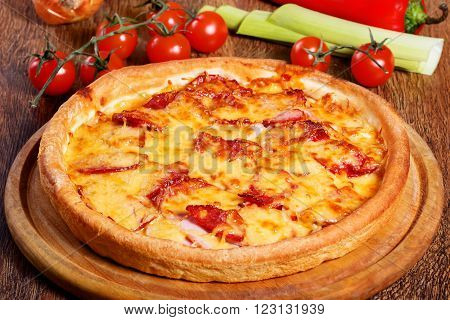 Pizza With Salami, Pastrami, Ham And Cheese Served On Wooden Table