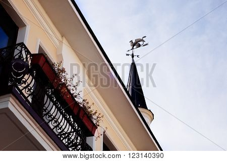 Balcony and tower with weather vane with griffin in Sukhumi, Abkhazia