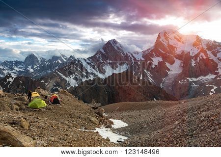 Sunbeams above Cloud Level at Mountain Peaks of Fan Valley in Tajikistan Tents of Extreme Climbers Bivouac on Rocky Moraine