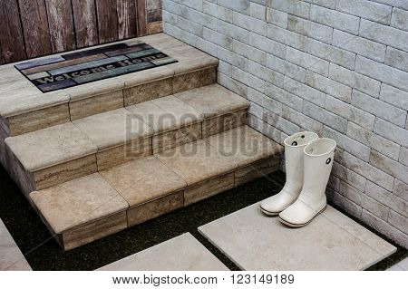 rubber Boots on a doorstep horizontal photo