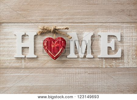 Home sweet home wooden text on vintage board background with copy space