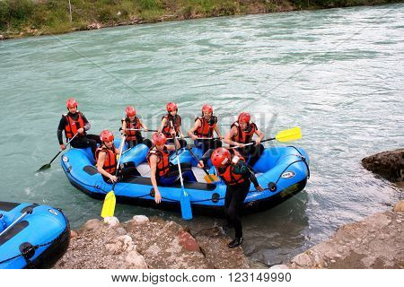 Foca, Bosnia: jun 2. 2015. Group of happy people with guide whitewater rafting and rowing on river ** Note: Visible grain at 100%, best at smaller sizes