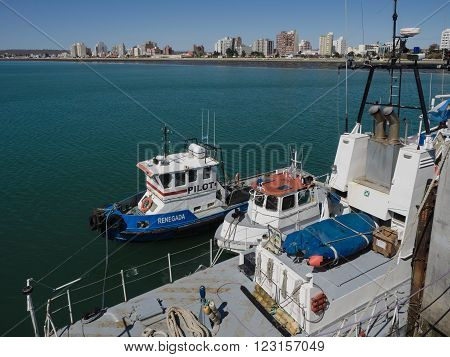 Puerto Madryn Argentina - 26th October 2015: Boats tied at he pier in spring.