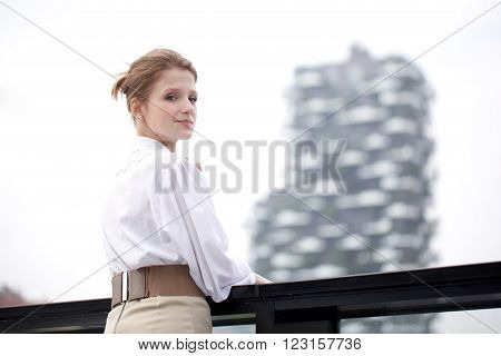 young beautiful blond businesswoman in urban environment