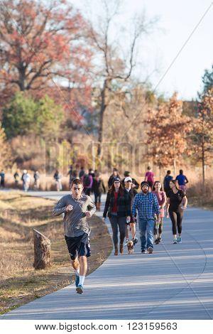ATLANTA, GA - DECEMBER 5 2015: People walk and run along the Atlanta Beltline recreational area in the Old Fourth Ward  in Atlanta GA on December 5 2015.