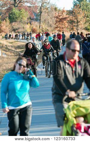 ATLANTA, GA - DECEMBER 5 2015: Dozens of people walk run and bike along the Atlanta Beltline recreational area in the Old Fourth Ward  in Atlanta GA on December 5 2015.
