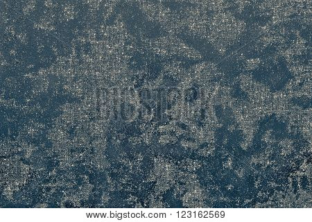 texture of textile fabric with spots from glossy scaly leather of dark green color for an abstract background or for the textured wallpaper