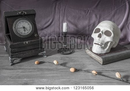 Halloween background, skull candles book on wooden board