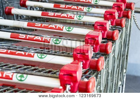 MATREI IN OSTTIROL, AUSTRIA - MARCH 28: Shopping baskets of the dutch multinational retail chain and franchise Spar stands in front of store on March 28, 2012 in Matrei in Osttirol, Austria.
