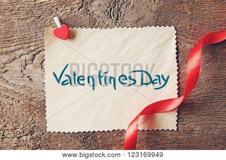 Blank present Valentine card on wooden background