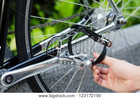 Close up of hand with bicycle pedal detail