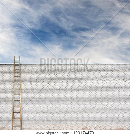 huge white brick wall with a wooden ladder and cloudy sky background