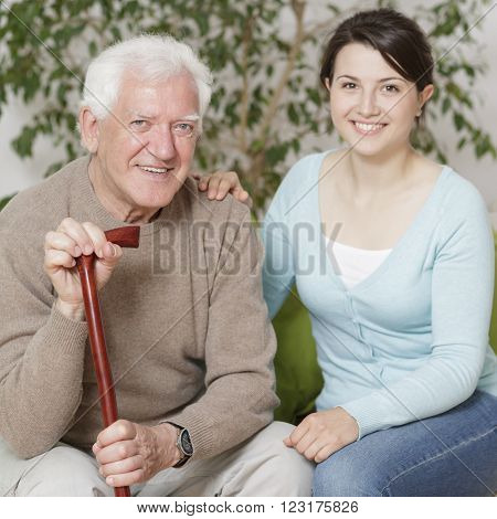 Content old man and young smiling granddaughter