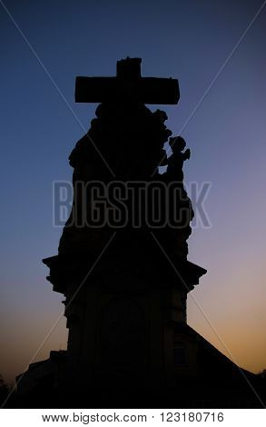 Black Statue Along The North Side Of Charles Bridge (karluv Most) On Sunset, Prague, Czech Republic.