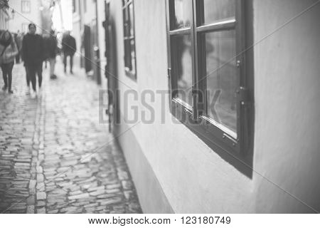 Homes Along The Golden Lane In Prague Castle, Full Of Tourist, Focus On Window, Black And White