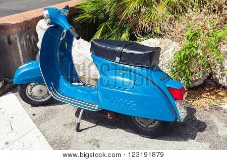 Classic Blue Vespa Sprint 150 Scooter Stands Parked