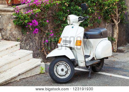 Classic White Piaggio Retro Scooter Stands Parked